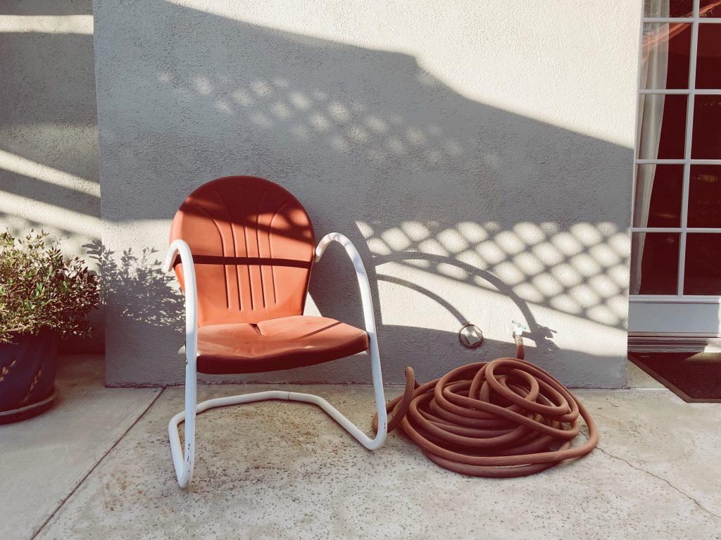 garden hose coiled on patio